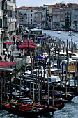 Boats and gondolas at a landing stage, Canale Grande, Venezia, Italy