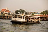 Public ferry on river Menam Chao Phraya, Bangkok, Thailand