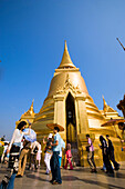 Tourists visiting Phra Sri Rattana Chedi, Wat Phra Kaew, the most important Buddhist temple of Thailand, Ko Ratanakosin, Bangkok, Thailand