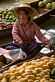 Woman offering fruits at Floating Market, Damnoen Saduak, near Bangkok, Ratchaburi, Thailand