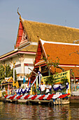 View over Chao Phraya River to a Temple, Thon Buri, Bangkok, Thailand