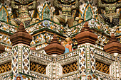 Tourists visiting the Wat Arun, Temple of Dawn, Bangkok, Thailand