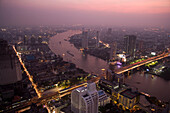 View from State Tower over Bangkok with Menam Chao Phraya River in the evening, Bangkok, Thailand