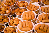 Dishes with spring rolls and Thai food offered at Suan Chatuchak Weekend Market, Bangkok, Thailand