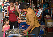 Child buying Sweets at Suan Chatuchak Weekend Market, Bangkok, Thailand