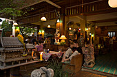 Tourists relaxing in a hotel bar, Banglamphu, Bangkok, Thailand