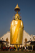 View to the gilded Buddha statue, 32 m high, Wat Intharawihan, Banglamphu, Bangkok, Thailand