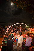 Young people at a Full Moon Party, bar in foreground, Hat Rin Nok, Sunrise Beach, Ko Pha-Ngan, Thailand