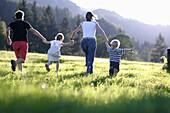 Family running in field