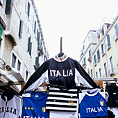 Italian trikots and sports shirts at a sales stall in the streets, Venice, Italy