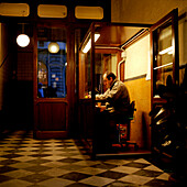 Doorman holding night watch at hotel entrance, Florence, Tuscany, Italy