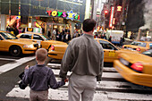 Toys are us, Father and son, crossing, Taxi, Yellow Cab, Shopping, Rush hour, Times Square, Manhattan, New York City, New York, United States of America, U.S.A.