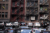 car park, parking lot, cars, fire escape stairs, brickstone buildings, Manhattan, New York City, New York, United States of America, U.S.A.