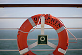 A life belt hanging at the railing, cruise ship MS Delphin Renaissance