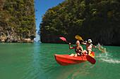 Couple kayaking, Ko Hong Island lagoon, Phang Nga bay, Krabi, Thailand