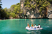 Tourists having a boat trip along Lading Island, Krabi, Thailand, after the tsunami
