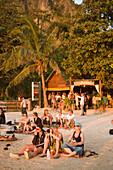 People sitting at beach near BoBo's Plaza and watching the sunset, Hat Rai Leh, Railay West, Laem Phra Nang, Railay, Krabi, Thailand, after the tsunami