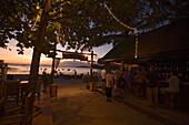 Tourists visiting BoBo's Plaza, a beach bar, at beach Hat Rai Leh, Railay West in the late evening, Laem Phra Nang, Railay, Krabi, Thailand, after the tsunami