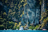 Boats in front of overgrown cliffy scenery, Ko Phi Phi Don, Ko Phi Phi Islands, Krabi, Thailand, after the tsunami
