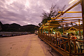People sitting on a beach terrace of a restaurant in the evening, Ko Phi Phi Don, Ko Phi Phi Island, Krabi, Thailand, after the tsunami