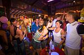 Young people in a bar, Ko Phi Phi Don, Ko Phi Phi Island, Krabi, Thailand, after the tsunami