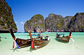 """View over Maya Bay, a beautiful scenic lagoon, famous for the Hollywood film """"The Beach"""" with anchored boats, Ko Phi-Phi Leh, Ko Phi-Phi Islands, Krabi, Thailand, after the tsunami"""