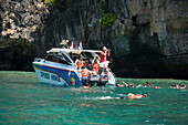 "Snorkeling trip to Maya Bay, a beautiful scenic lagoon, famous for the Hollywood film ""The Beach"", Ko Phi-Phi Leh, Ko Phi-Phi Islands, Krabi, Thailand, after the tsunami"