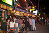 Tourists sitting in open-air bars at Bang-La Road in the evening, bar district, Patong Beach, Ao Patong, Hat Patong, Phuket, Thailand, after the tsunami