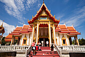 People visiting Ubosot, Wat Chalong, Phuket, Thailand