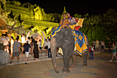 Tourists riding on a elephant, Palace of the Elephants, Phuket Fantasea, Nighttime Cultural Theme Park, Kamala Beach, Phuket, Thailand
