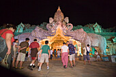 People walking through entrance of Palace of the Elephants, Phuket Fantasea, Nighttime Cultural Theme Park, Kamala Beach, Phuket, Thailand