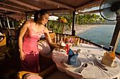 Waitress serving a cool drink, Baan Rim Pa restaurant, Patong Beach, Hat Patong, Ao Patong, Phuket, Thailand, after the tsunami