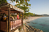 Young woman standing on terrace of Baan Rim Pa restaurant and enjoying the stunning ocean view, Patong Beach, Hat Patong, Ao Patong, Phuket, Thailand, after the tsunami