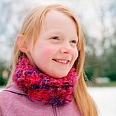 Young girl (9-10 years) smiling, portrait