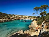 View of a bay with sailing boats, Cala de Sanau, near Porto Colom, Mallorca, Spain