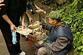 path and stairs, sales people, selling handmade straw sandals, traditional pilgrim sandals, mountains, Emei Shan, China, Asia, World Heritage Site, UNESCO