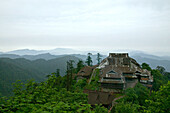 view over corrugated iron roofs of the Xixiang Chi monastery and temple, forest green, Elephant Bathing Pool, World Heritage Site, UNESCO, China, Asia