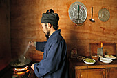 A monk cooking in the kitchen of the monastery Cui Yun Gong, Hua Shan, Shaanxi province, China, Asia
