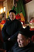 A monk and a nun at the monastery at Golden Lock Pass, Hua Shan, Shaanxi province, China, Asia