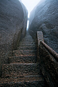 steep rock carved stone steps to Jade Screen Peak, Huang Shan, Anhui province, steep climb, stone steps, World Heritage, UNESCO, China, Asia