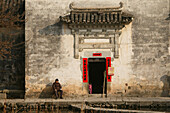 Open gate with New Year's decoration, view at a courtyard, Hongcun, Huangshan, China, Asia
