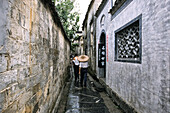 narrow lane between historic homes in ancient village, Hongcun, Huangshan, ancient village, living museum, China, World Heritage Site, UNESCO