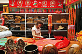 A woman working at a tailor shop for monk's robes, Jiuhuashan, Anhui province, China, Asia