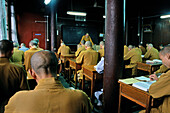 Monks at the lecture hall of the Buddhist College, Jiuhua Shan, Anhui province, China, Asia