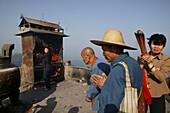 Pilgrims burning incense sticks on the mountain top at Tian Tai Feng monastery, Jiuhua Shan, Anhui province, China, Asia