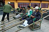 Porter with sedan chair for tired tourists, Jiuhuashan, Mount Jiuhua, mountain of nine flowers, Jiuhua Shan, Anhui province, China, Asia