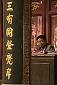 clerk in office, Huiji monastery, Buddhist Island of Putuo Shan near Shanghai, Zhejiang Province, East China Sea, China, Asia