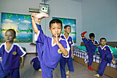 Very young pupils in the dormitory, Kung Fu training at kindergarten age at one of the many new Kung Fu schools in Dengfeng, Song Shan, Henan province, China