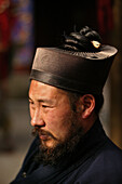 Taoist monk wearing headwear for long hair with an opening for plaits, Azure Clouds Temple, Tai Shan, Shandong province, Taishan, Mount Tai, World Heritage, UNESCO, China