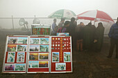 pilgrims, tourists in rain capes, entrance Bixia Si temple in fog, photographer sells photos, Tai Shan, Shandong province, Taishan, Mount Tai, World Heritage, UNESCO, China, Asia